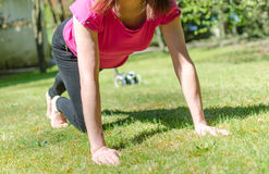 Woman doing physical exercises Royalty Free Stock Photo