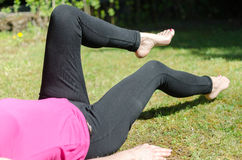 Woman doing physical exercises Stock Images