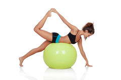 Woman doing pilates with a ball Royalty Free Stock Photography