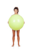 Woman doing pilates with a ball. Woman with a ball isolated on white background stock image