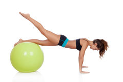 Woman doing pilates with a ball. Woman doing sports with a ball isolated on white background royalty free stock photos