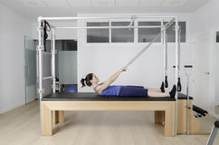 Woman doing pilates in cadillac. Royalty Free Stock Images