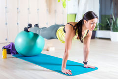 Woman doing pilates exercises with fit ball in gym Royalty Free Stock Image