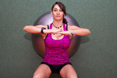 Woman doing pilates with fitball Stock Images