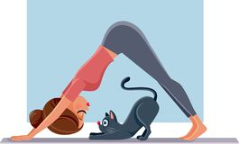 Funny Girl Exercising Next to Her Cat on Yoga Mat. Woman doing Pilates next to her pet friend stretching together