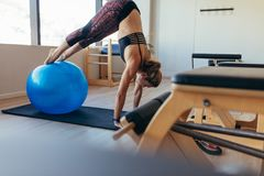 Woman doing pilates workout at a gym Royalty Free Stock Image