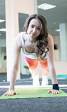 woman doing plank exercise in gym or yoga stock images