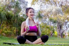 Woman doing practice yoga posee in the park , beautiful young woman sitting relax yoga time stock image