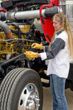 Woman doing pre-trip inspection. royalty free stock image