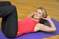 Woman doing press exercise. Beautiful sport woman doing press fitness exercise at sport gym Royalty Free Stock Photo