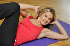 Woman doing press fitness exercise Royalty Free Stock Photography