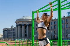Woman doing pull-up Stock Image