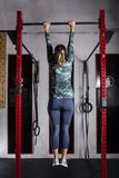 Woman training pull-up stock photos