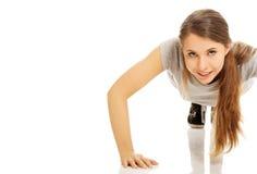 Woman doing pumps Royalty Free Stock Photos
