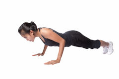 Woman doing push up exercise, isolated
