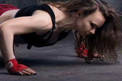 Woman doing push up Stock Images