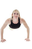 Woman doing push ups Royalty Free Stock Image