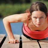 Woman doing push-ups Royalty Free Stock Photos