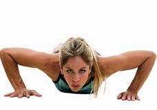 Woman doing push-ups Royalty Free Stock Images