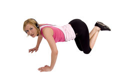 Woman doing push-ups. A blond Swedish fitness model is doing push-ups stock photography
