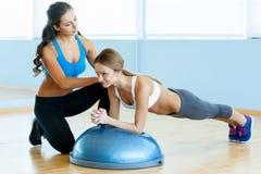 Woman doing push-ups. Royalty Free Stock Photos
