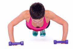 Woman doing push-ups Royalty Free Stock Image