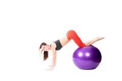 Woman doing push-ups Royalty Free Stock Image