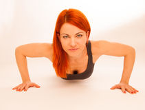 Woman doing push ups in fitness Royalty Free Stock Photos