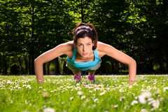 Woman doing push ups fitness workout Stock Photos