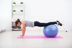 Woman Doing Push Ups On The Floor With Fit Ball In Royalty Free Stock Image