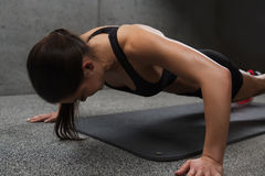 Woman doing push-ups in gym. Fitness, sport, people and exercising concept - woman doing push-ups in gym Stock Photo