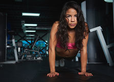 Woman doing push ups in gym Royalty Free Stock Photo