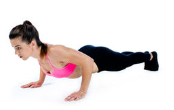 Woman doing push ups isolated Royalty Free Stock Images