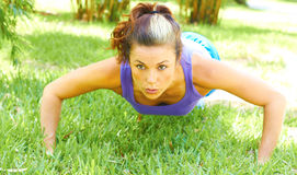 Woman Doing Push Ups In Park Royalty Free Stock Photography