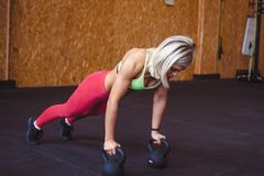 Woman doing push-UPS stock images