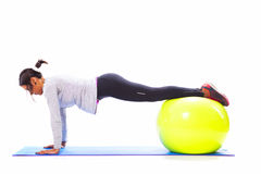 Woman doing push ups Stock Images