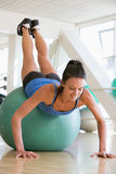 Woman Doing Push Ups On Swiss Ball At Gym Royalty Free Stock Photo