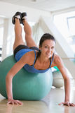 Woman Doing Push Ups On Swiss Ball At Gym royalty free stock photography