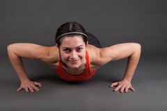 Woman doing a pushup Royalty Free Stock Photography