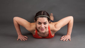 Woman doing a pushup Stock Photography