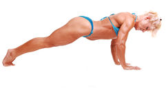 Woman doing pushups. Stock Image