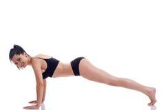 Woman doing pushups Stock Photos