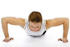 Woman doing pushups Stock Photo