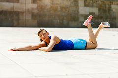 Woman doing pushups outdoor. Resting after exercise. Stock Images
