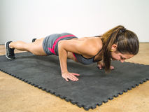 Woman doing pushups Stock Images