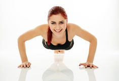 Woman doing pushups Royalty Free Stock Photos