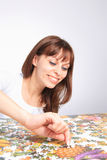 Woman doing  puzzle Royalty Free Stock Photo