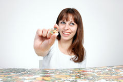 Woman doing  puzzle Royalty Free Stock Image