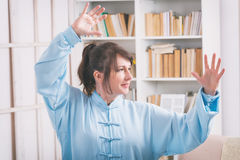 Woman doing qi gong tai chi exercise Royalty Free Stock Images
