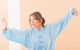 Woman doing qi gong tai chi exercise Royalty Free Stock Photography